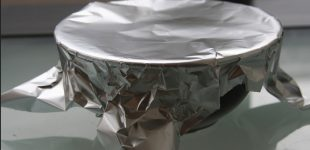 The Shocking Reason Everyone Needs To Stop Cooking With Aluminum Foil